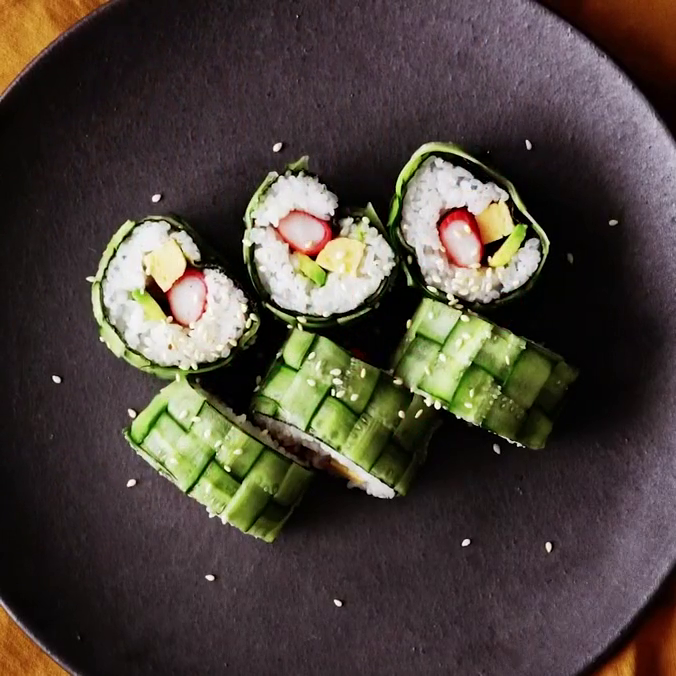 Cucumber rolls with crab sticks, omelette and avocado