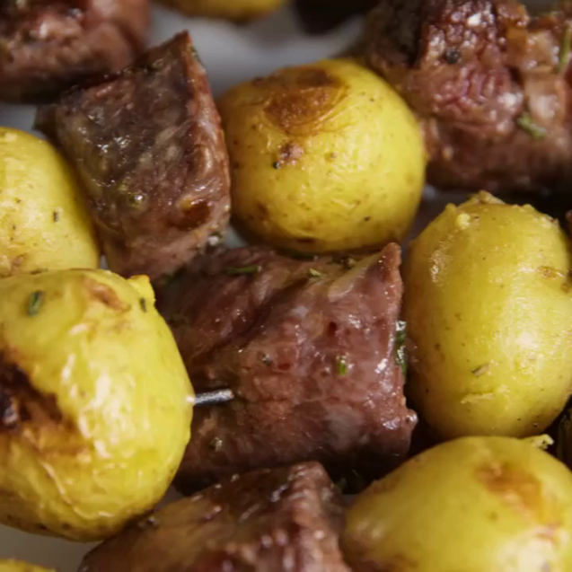 Potato with meat on skewers